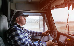 Truck driver in his vehicle